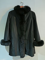 Reversible black sheared mink coat with fox trim