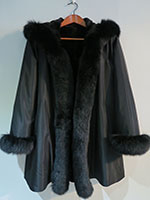 Reversible black sheared mink coat with fox trim and hood