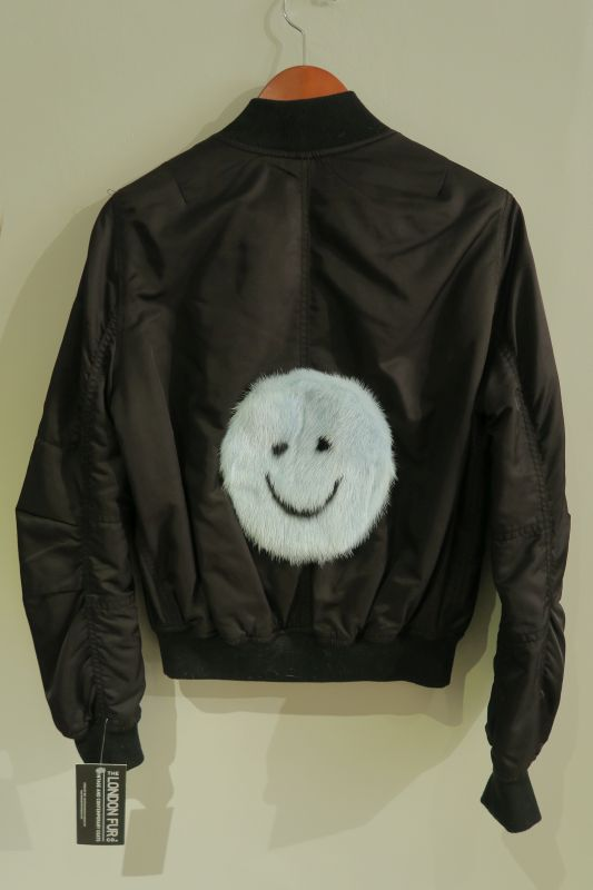 Upcycled black bomber with baby blue mink smiley