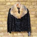 Broadtail lamb coat with raccoon collar
