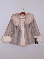 Silver grey mink cape with fox trim