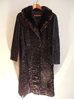 Fitted black Swakara lamb coat with mink collar