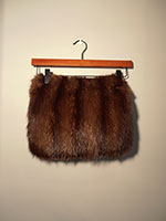 Mink muff with zipped pocket at back
